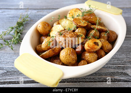 Baked potatoes in a bowl, food close-up - Stock Photo