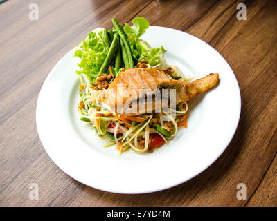 SOMTAM with Grilled Salmon in white dish - Stock Photo