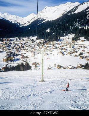 Chairlift and Morgins village ski resort Swiss Alps Valais Switzerland - Stock Photo