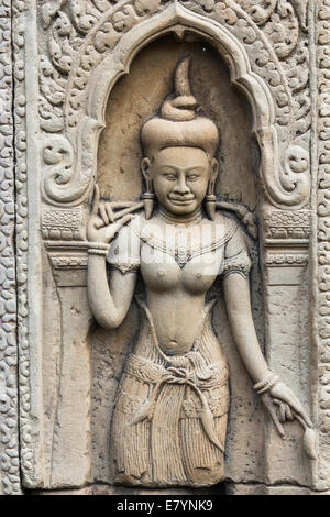 Sculpture of a Hindu goddess on a wall at the ancient Hindu temple complex of Angkor Wat, near Siem Reap, Cambodia. - Stock Photo
