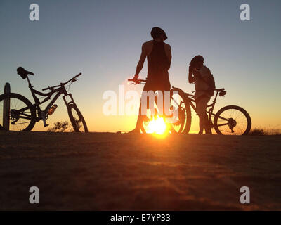 Laguna Beach, California, USA. 22nd Sep, 2014. A mountain biker rides his bike up Canyon Acres trail in Aliso Woods - Stock Photo