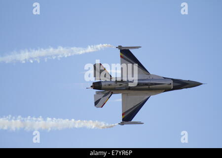 A F-16AM from the Belgian Air Force creates vapour trails at the 2014 Tatoi Airshow. The Tatoi Air Show, the main - Stock Photo