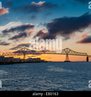 Astoria bridge over Columbia River at sunset. The Astoria-Megler bridge connects Oregon with Washington State. - Stock Photo