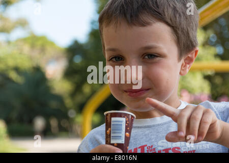 child smiling with popsicle, child with lolly, child with ice-cream - Stock Photo