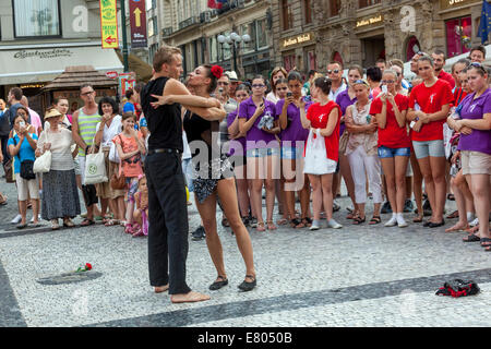 Street acrobats demonstrate their show in front of tourists, People on  Wenceslas Square, Mustek, Prague, Czech - Stock Photo