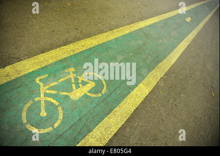 Detail with a bicycle lane in the park - Stock Photo