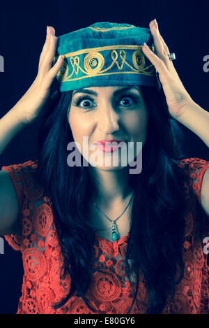 Woman wearing traditional middle eastern hat - Stock Photo