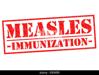 MEASLES IMMUNIZATION red Rubber Stamp over a white background. - Stock Photo