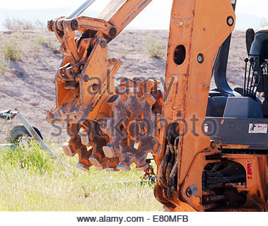Pad Foot Roller Compactor attachment on backhoe Arizona - Stock Photo