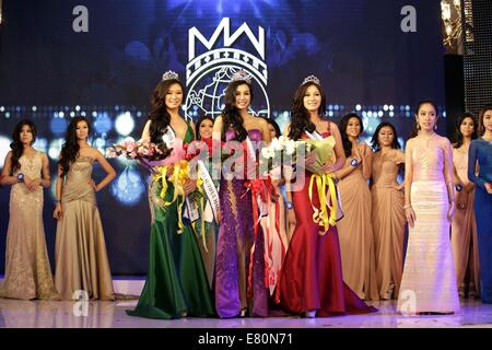 Yangon. 27th Sep, 2014. Miss Myanmar World Wyne Lay (C Front) poses for photos after winning the crown at the Miss - Stock Photo