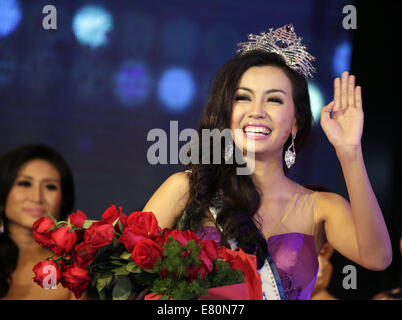 Yangon. 27th Sep, 2014. Miss Myanmar World Wyne Lay gestures after winning the crown at the Miss Myanmar World 2014 - Stock Photo