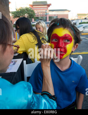 Los Angeles, USA. 27th Sep, 2014. A child gets a Peking Opera facial make-up during the celebrations in Los Angeles - Stock Photo