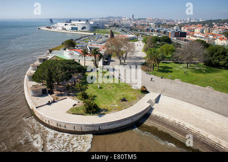 Promenade and park along Belem District waterfront by the Tagus river in Lisbon, Portugal, view from above. - Stock Photo