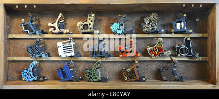 A selection of tattooing irons on display at the 10th International London Tattoo Convention, Tobacco Dock, London. - Stock Photo