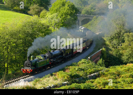Two steam locomotives at Darnholme near Goathland on the North Yorkshire Moors steam heritage rail line. - Stock Photo