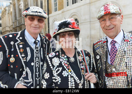 Guildhall Yard, London, UK. 28th September 2014. Three Pearlys at the annual  London Pearly Kings & Queens Society - Stock Photo