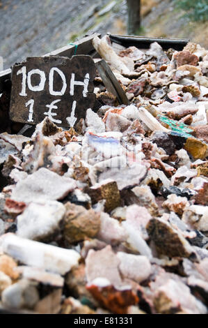 Vertical close up of fragments of crystalised rocks for sale in the High Atlas Mountain range in Morocco. - Stock Photo