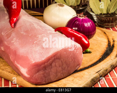 Raw meat on wooden board. - Stock Photo