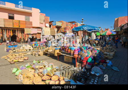 Horizontal view of stalls and shops selling handicrafts in the open air souks of Marrakech. - Stock Photo