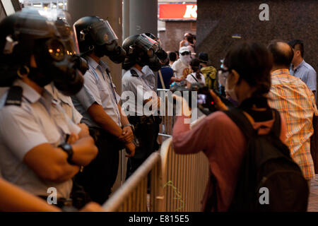 Hong Kong. 28th Sep, 2014. Police guarding barriers at Occupy Central protests, Hong Kong, China.   Protests against - Stock Photo