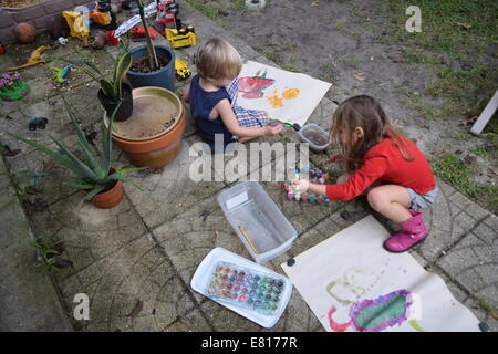 kids painting water color art outside - Stock Photo