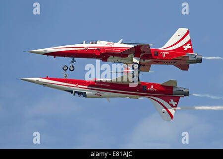 F-5 Tiger II aircraft of the Patrouille Suisse aerobatic team, demonstrate the calypso pass during the AIR14 air - Stock Photo
