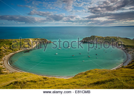 Evening view over Lulworth Cove along the Jurassic Coast, Dorset, England - Stock Photo