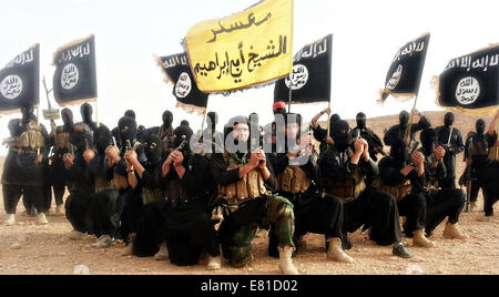 Islamic State of Iraq and the Levant fighters pose in a propaganda photo released by the organization. - Stock Photo