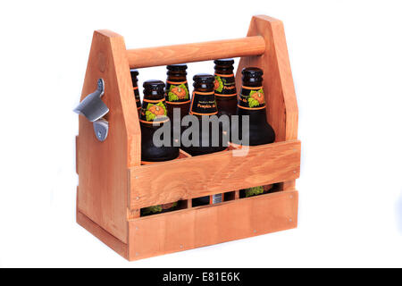 Buffalo Bill's Brewery Pumpkin Ale in a wood 6-pack carrier with bottle opener - Stock Photo