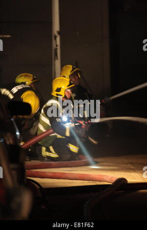 Edmonton London, UK. 28th Sep, 2014. Some 60 FireFighters from across London called to tackle a fire in a single - Stock Photo