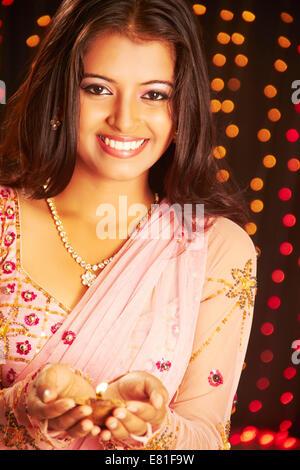 indian Beautiful ladies diwali Festival diya - Stock Photo