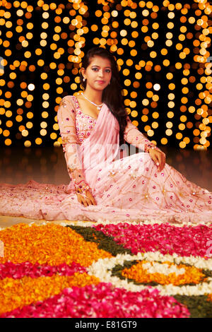 indian ladies Festival diwali Rangoli - Stock Photo
