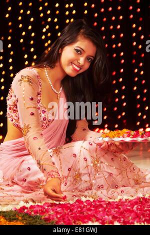 indian ladies Festival diwali Rangoli - Stock Photo