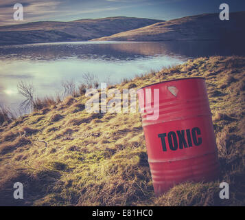 Toxic Waste Barrel Near Water In The  Countryside - Stock Photo