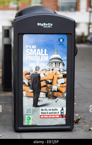 Poster advertising 'It's no Small problem' Campaign on the side of a Rubbish Bin In London England - Stock Photo