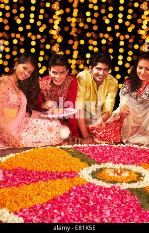 indian friends Festival diwali Rangoli - Stock Photo