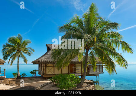 Overwater bungalow, Moorea, French Polynesia - Stock Photo