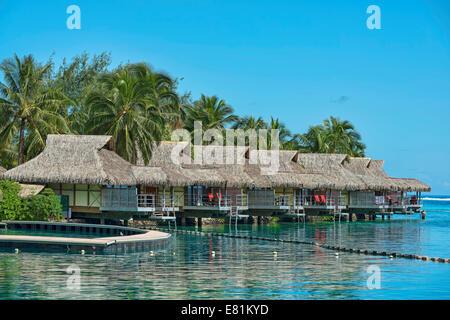 Overwater bungalows, Moorea, French Polynesia - Stock Photo