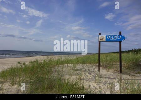 Sandy beach on the Baltic Sea with sign for a cafe, Verbelnieki, Nīca, Latvia - Stock Photo