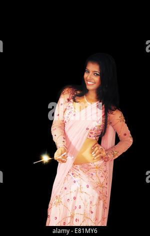 indian Ladies diwali Festival Fire Cracker - Stock Photo