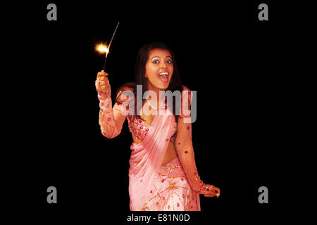 indian Ladies diwali Festival Fire Cracker - Stock Photo