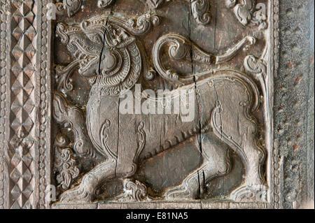 Ornate wood carving, Sinhalese lion, Embekke Devale Temple, near Kandy, Central Province, Sri Lanka - Stock Photo