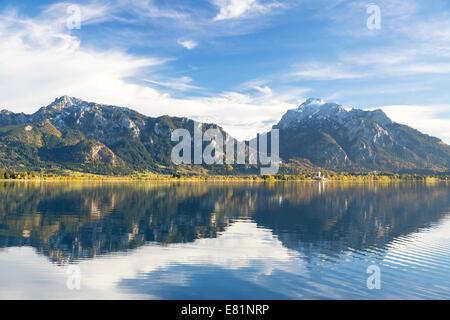Autumn mood with mountain views on Forggensee lake near Füssen, East Allgäu, Bavaria, Germany - Stock Photo