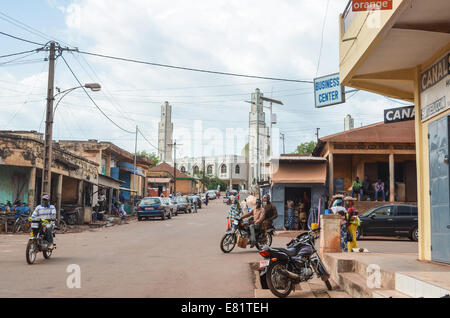 Motorbikes in a market street leading to the mosque in Labe, region of the Fouta, Guinea - Stock Photo