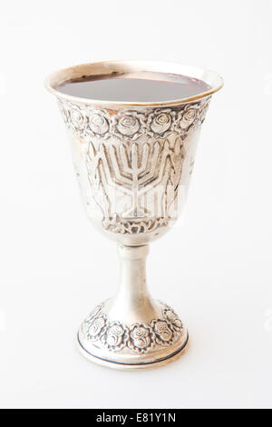 Rosh Hashanah Kiddush cup honey pomegranate and sliced apple - Stock Photo