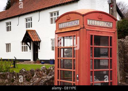 UK, England, Somerset, Sampford Brett village K6 red phone box - Stock Photo