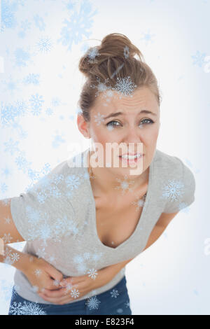 Young woman suffering from stomach pain - Stock Photo