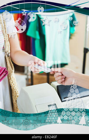 Close up of a cute woman paying with her credit card - Stock Photo