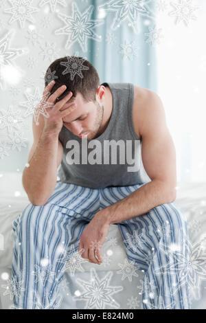 Portrait of a sad man sitting - Stock Photo