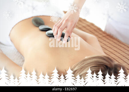 Radiant woman having a stone therapy - Stock Photo